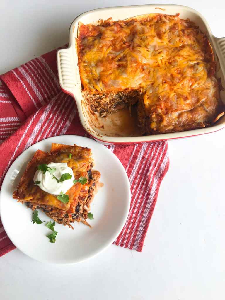 Just 5 ingredients and little effort stand in between you and this comforting, filling, weeknight 5-Ingredient Chicken Enchilada Bake. Just layer the enchilada ingredients like a lasagna and you're good to go. No messy rolling here. Recipe at KathleensCravings.com #weeknightmeal #5ingredientdinner #easychickendinner #enchiladacasserole
