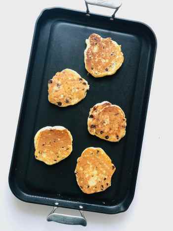 Simple, staple Fluffy Chocolate Chip Pancakes. But made EXTRA thick and fluffy thanks to our DIY buttermilk. And did I mention the chocolate chips? Your weekend mornings just got a serious upgrade. Recipe at KathleensCravings.com #fluffypancakes #weekendbreakfast #scratchpancakes