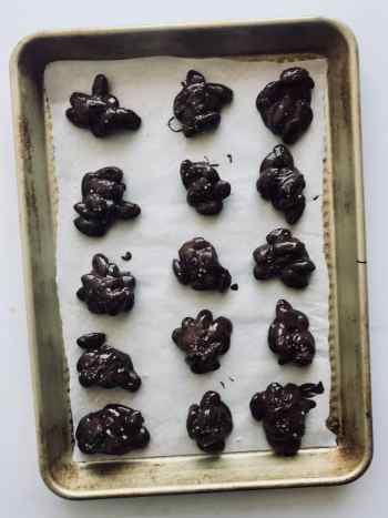 These Sea Salt Chocolate Almond Clusters are only 4 ingredients and the perfect salty and sweet treat. Make a batch and store in the refrigerator for up to 4 weeks to have a go-to treat throughout the holiday season. Recipe at KathleensCravings.com. #holidaytreats #holidayparty #holidaydesserts #easydesserts