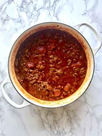 Filling and comforting, this Simple Chunky Spaghetti Sauce satisfies your bolognese craving without needing hours simmering on the stove. Using just a few pantry ingredients and just 30 minutes of cook time. Perfect weeknight meal. Recipe at KathleensCravings.com #Weeknightdinner #easypastasauce #simplespaghetti #chunkymeatsauce