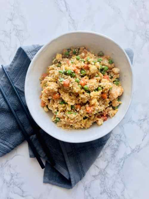 Kimchi Fried Rice. A comforting meal or side dish made with just a few simple ingredients. Just 15 minutes start to finish. Recipe at KathleensCravings.com #takeoutfakeout #asianmealprep