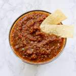 This homemade Smoky Chipotle Salsa takes just 5 minutes to make! And using canned tomatoes, it's extra easy! A slight kick from jalapeño and smokiness from the chipotle peppers. You need this salsa for your next Mexican fiesta. Recipe at KathleensCravings.com #homemadesalsa #easyhomemadesalsa