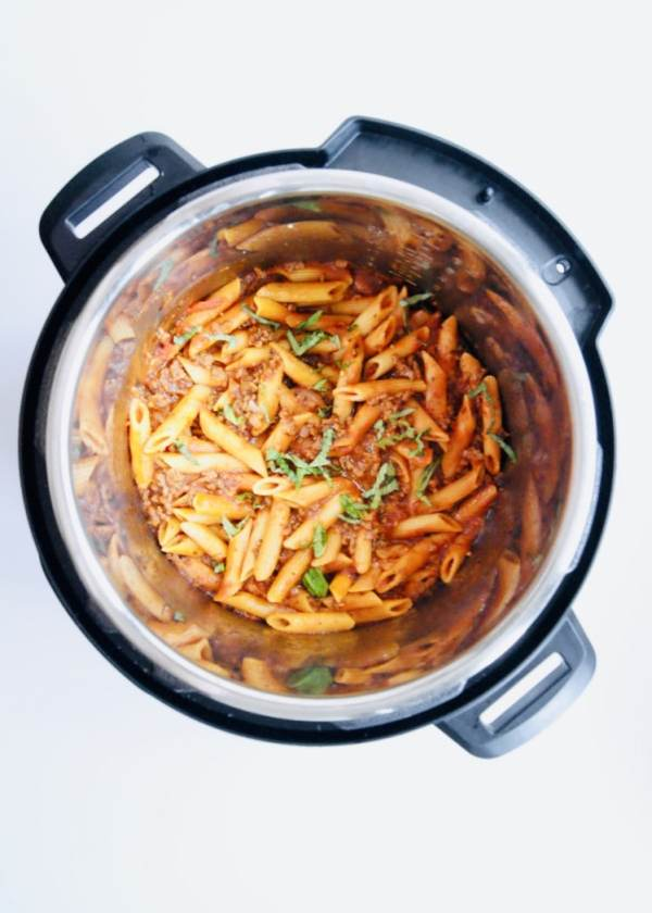 All made in one-pot at one time. Just a 5 minute cook time.  AND using affordable ingredients that you probably already have in your pantry! This easy pasta with meat sauce is hearty, delicious, and budget friendly. Recipe at KathleensCravings.com #KathleensCravings #InstantPotPasta #OnePotPasta #InstantPotBolognese #InstantPotMeatSauce
