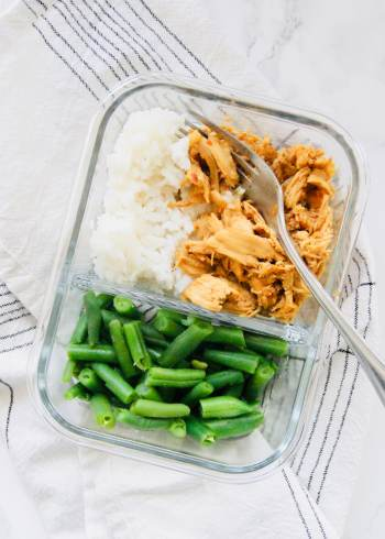 Slow Cooker Chicken in meal prep container with veggies and rice