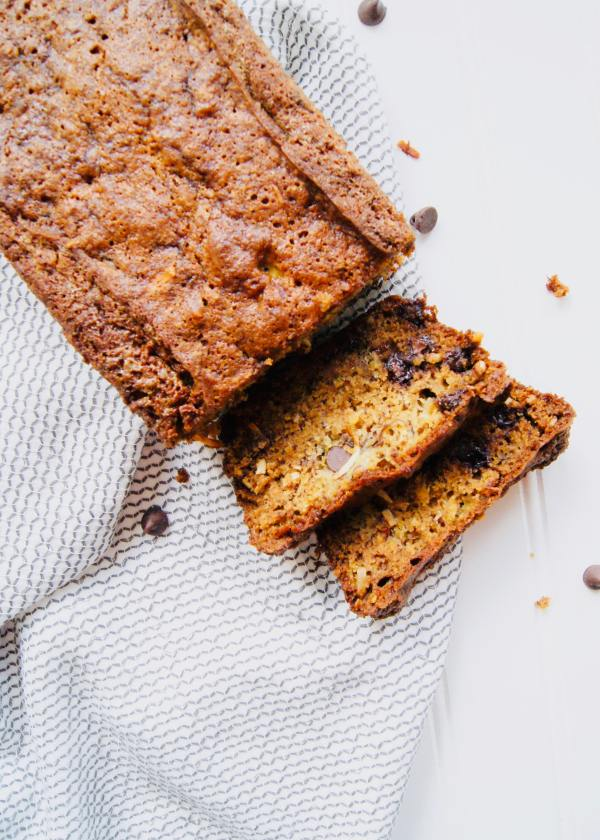 This is the ultimate banana bread. Extra moist and loaded with banana flavor. Use up those ripe bananas sitting on your counter and bake up this bread. No mixer needed! Recipe at KathleensCravings.com #KathleensCravings #bananabread #bananarecipe #baking #fallbaking #bestbananabread #chocolatechipbananabread