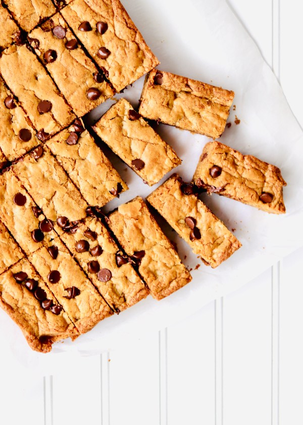 Almond Butter Chocolate Chip Cookies Bars have the same cookie flavor that we love, but thicker, chewier, and easier to make. No need to scoop the dough. Just mix in one bowl, spread into a dish, and bake. Recipe at KathleensCravings.com #kathleenscravings #blondies #chocolatechips #cookiebars #baking #desserts #onebowl