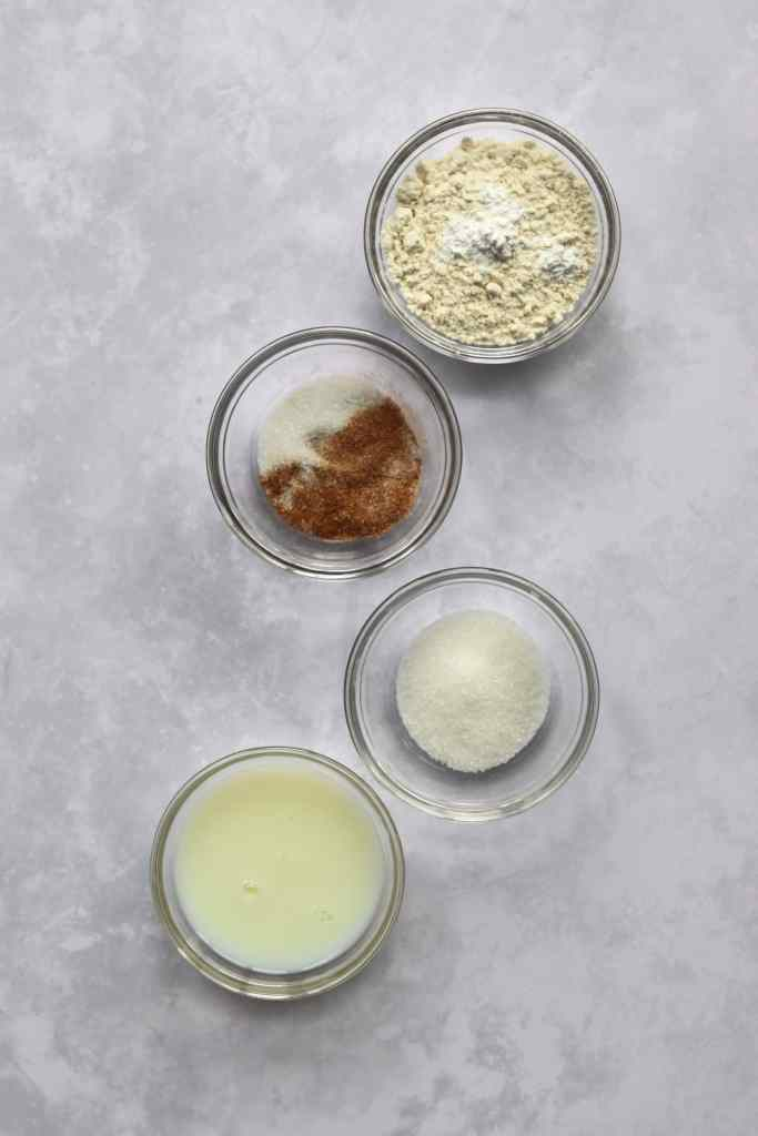 Flour, cinnamon sugar, sugar, and milk in bowls