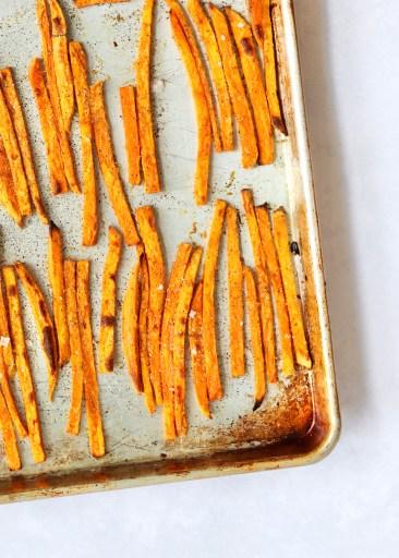 Sweet potato fries on a sheet pan