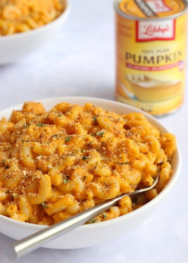 Bowl of pumpkin Mac and cheese with can of Libbys pumpkin puree