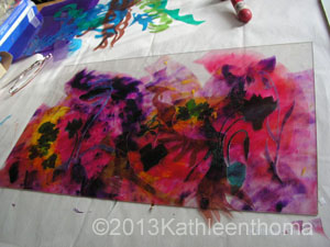 Layers of paint and stencils on the plate