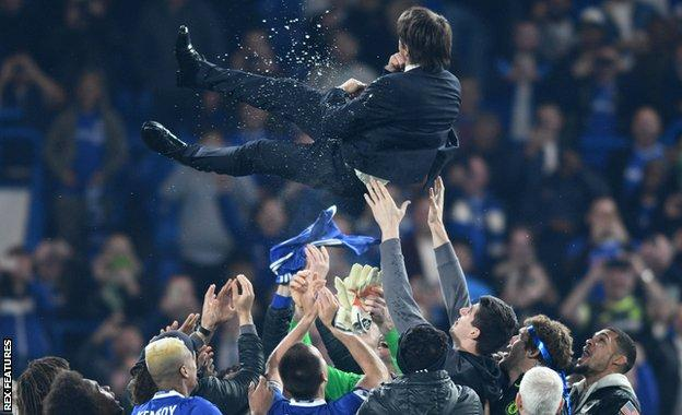 Antonio Conte, who was hoisted up by his players after the game