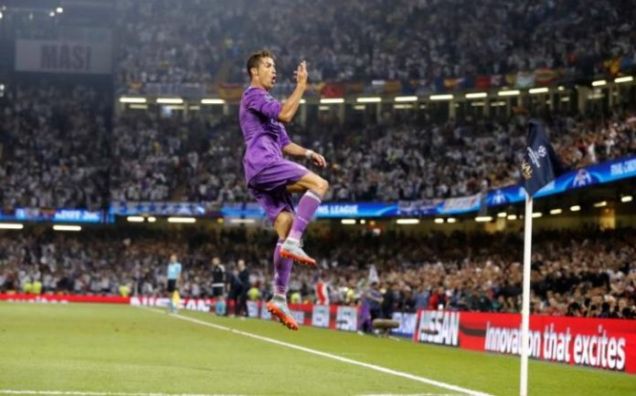 Real Madrid's Cristiano Ronaldo celebrates after scoring the opening goal CREDIT: AP
