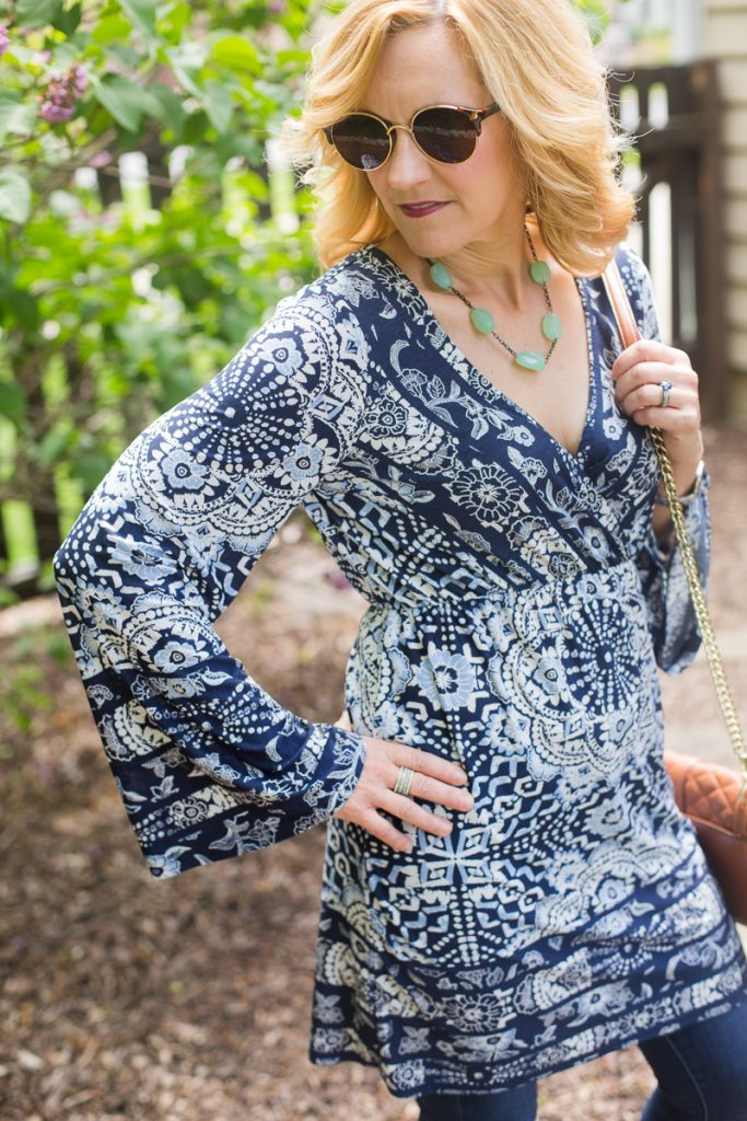 A boho tunic dress with bell sleeves.