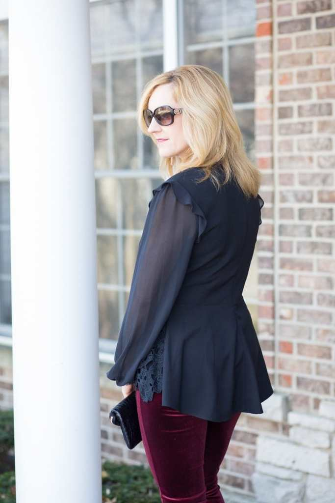 Back Detail of Sheer Long Sleeved Peplum Top by Kensie