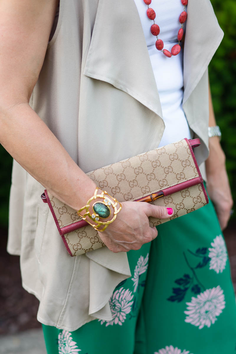 Gucci Clutch with a Draped Vest and Printed Pants