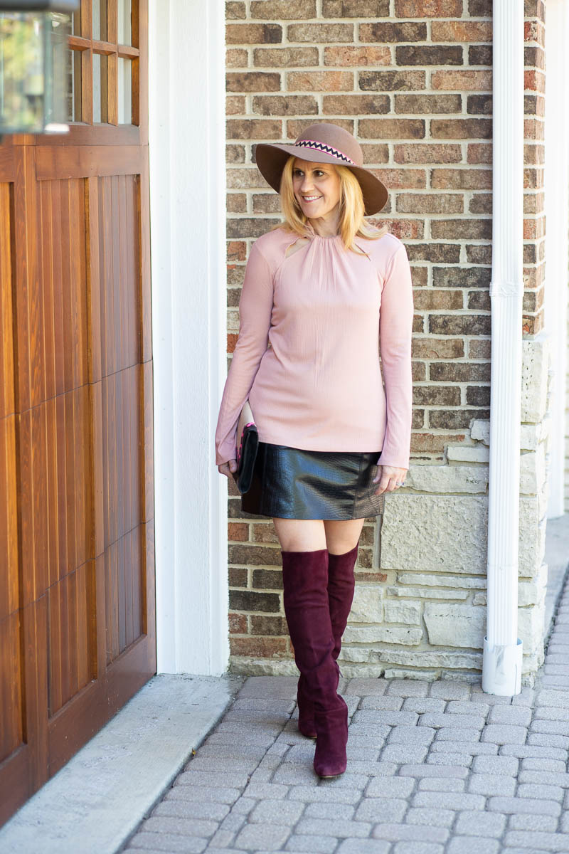 Mixing shades of pink with a blush long sleeve blouse and burgundy over the knee boots.