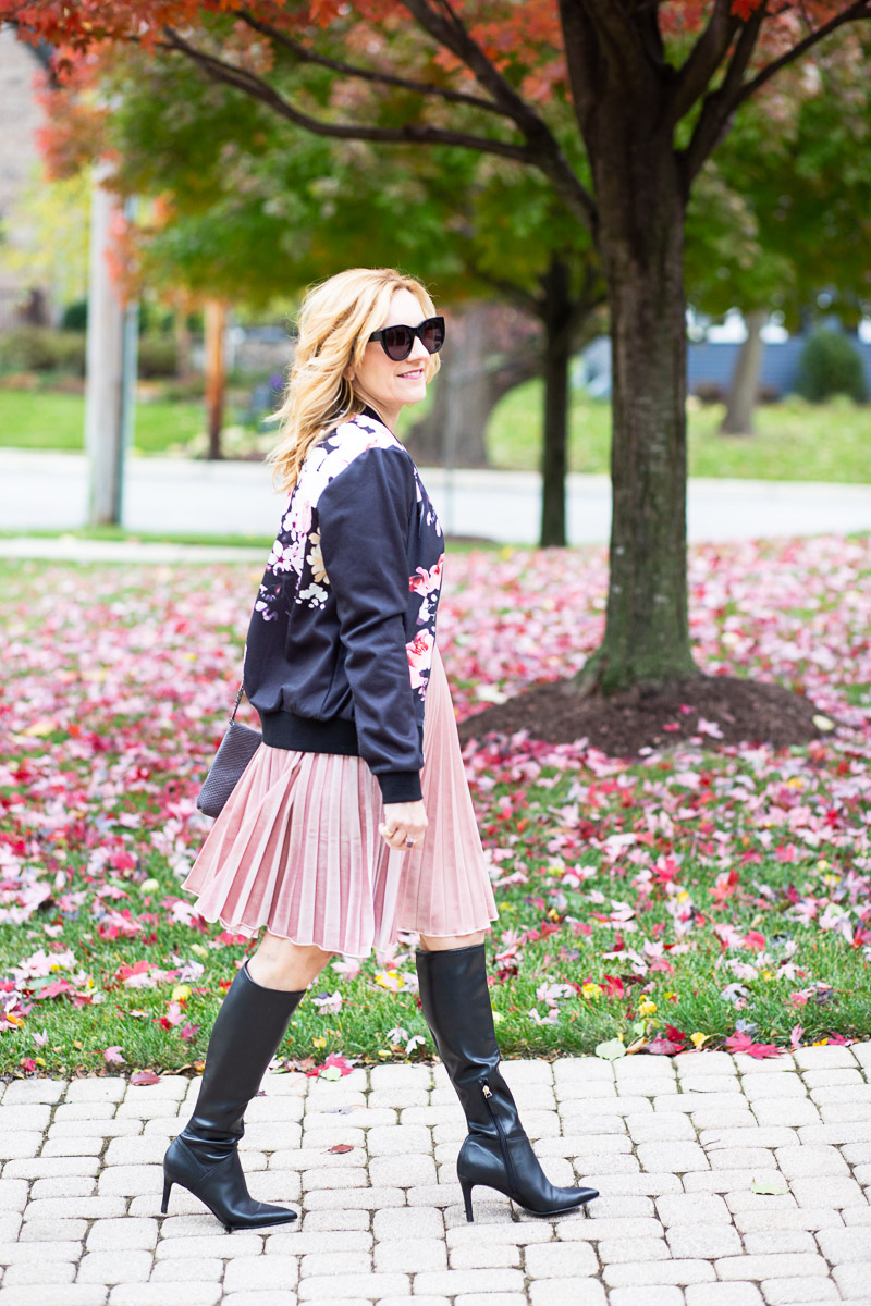 Layering over a spring dress for a chic Thanksgiving outfit.