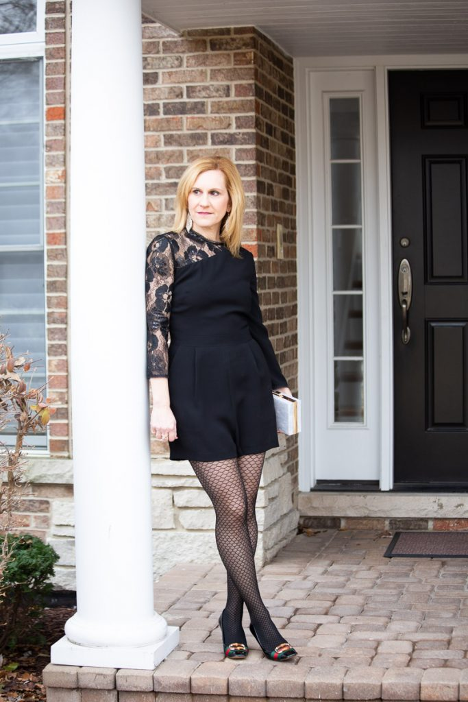 Wearing a black lace romper for New Year's Eve.
