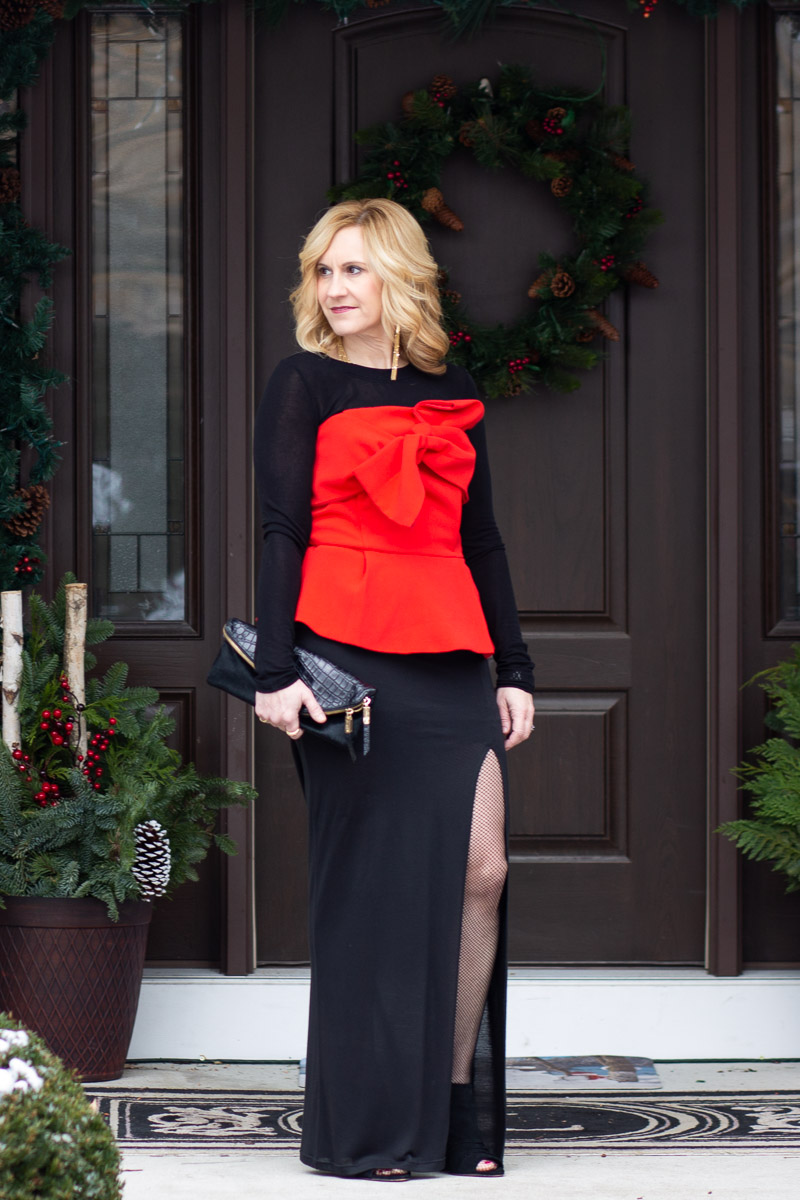 Red and black holiday look featuring a strapless bow top with a long sleeved tee and maxi skirt.