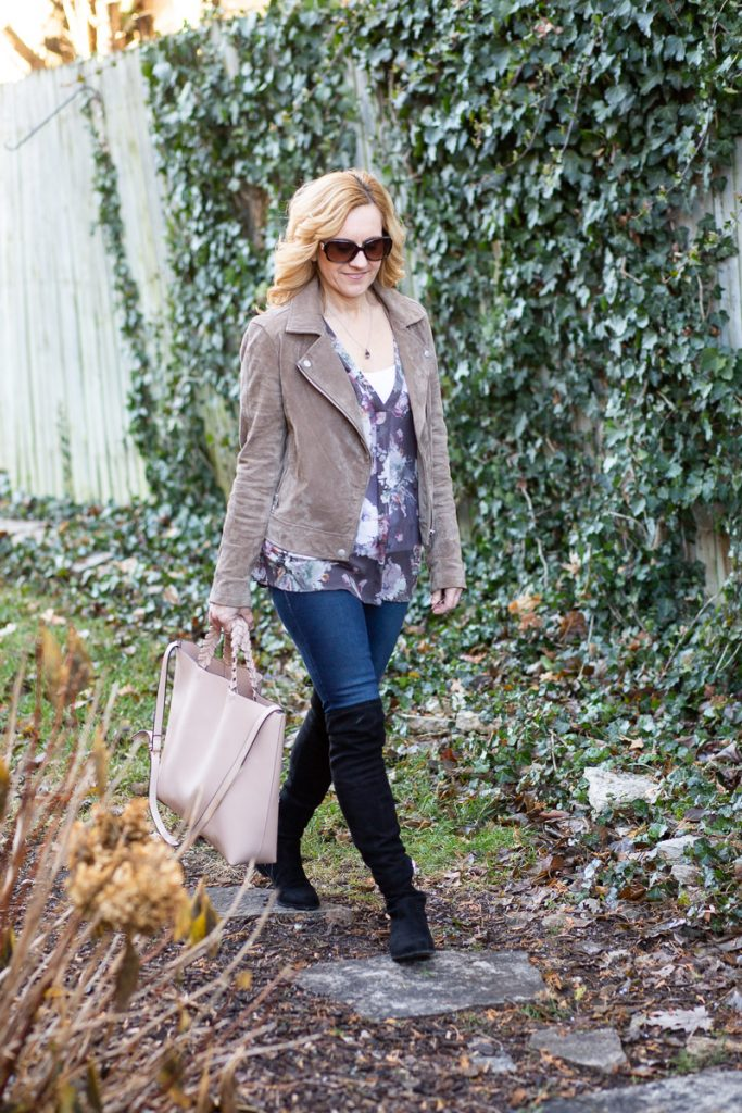 Styling a suede moto jacket with a floral top, skinny, and over the knee boots.
