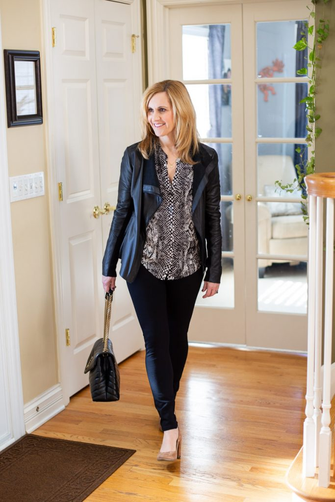 Styling a leather jacket and snakeskin top with black leggings.
