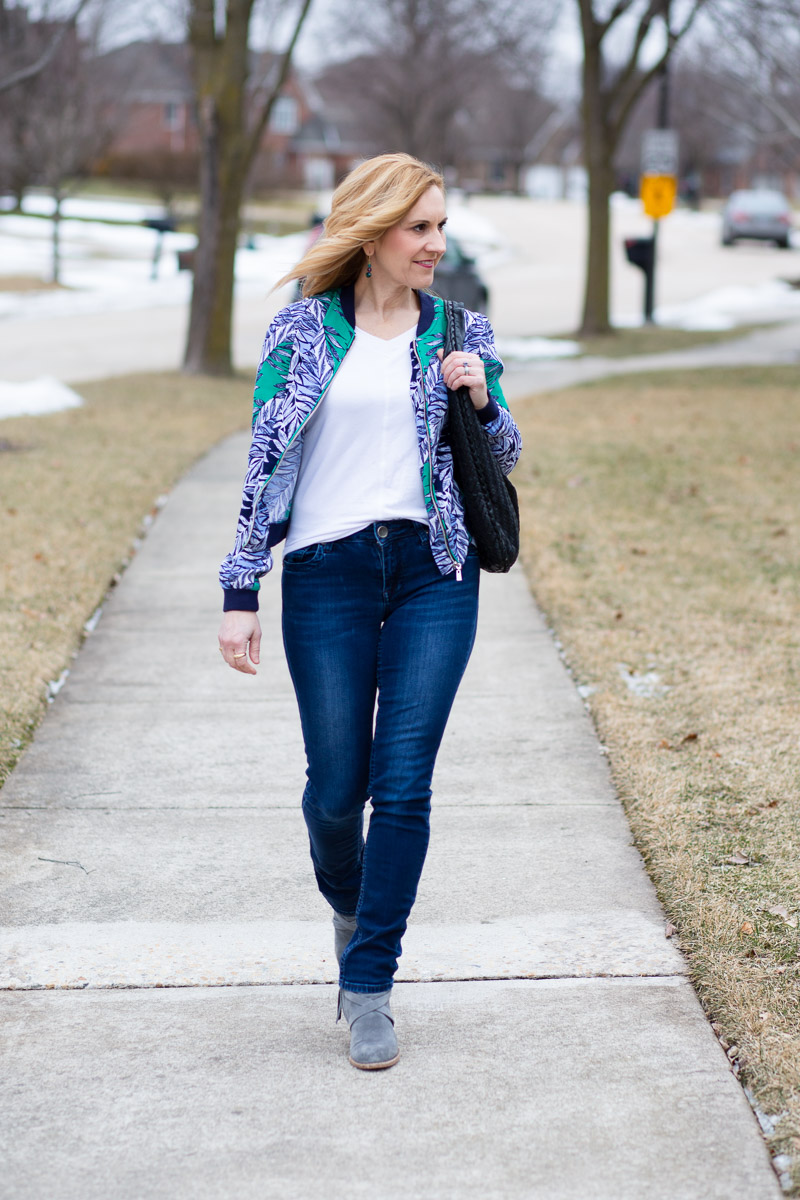 Changing up a classic casual look with a printed bomber jacket.