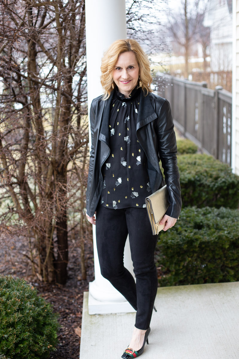 Styling a leather jacket with a sleeveless scattered tulip top and faux suede leggings.