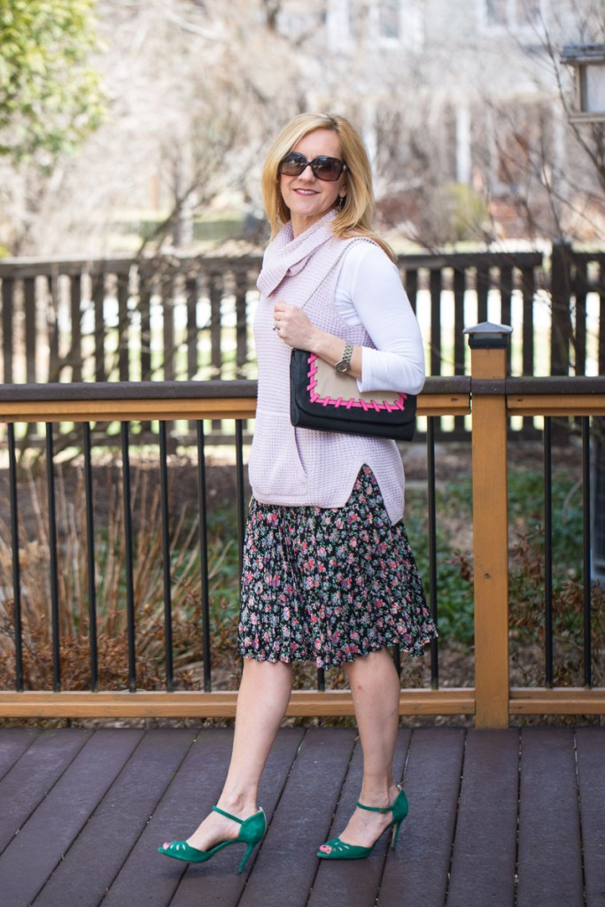 Adding a pink sweater vest to a floral skirt for a transitional Spring look.