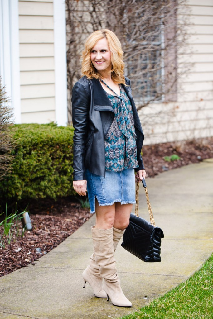 Adding a printed bow blouse to a leather jacket and denim pencil skirt.