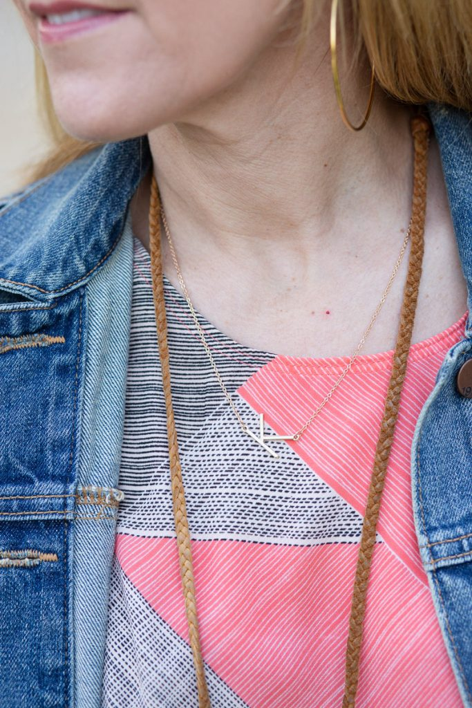 K initial necklace with printed tank and denim jacket.