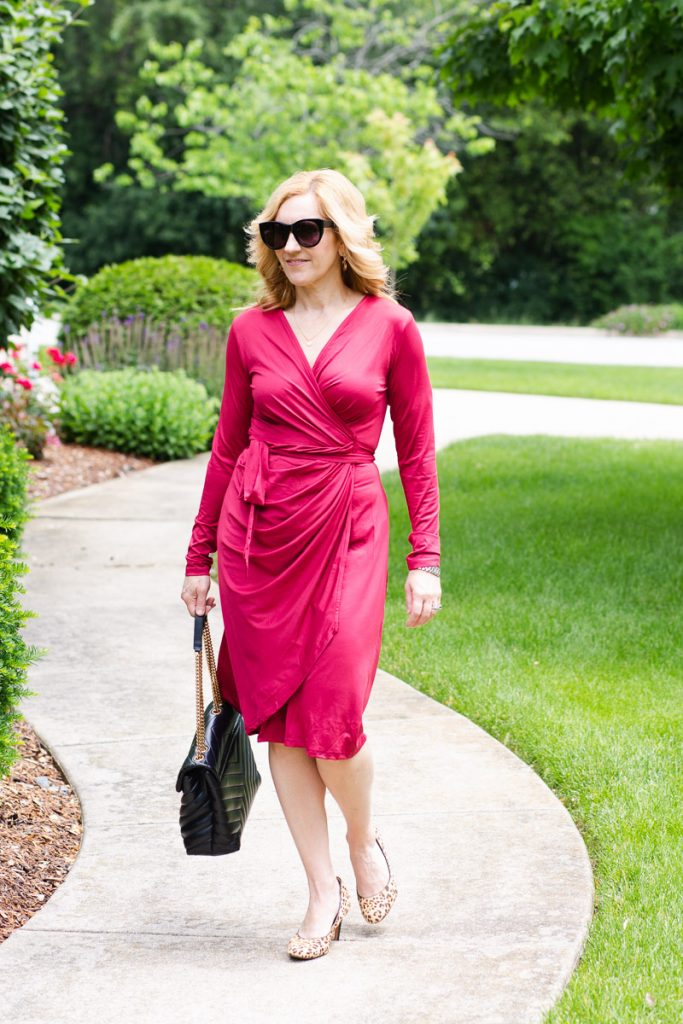 Wearing a wine-colored wrap  dress perfect for work in the summer.