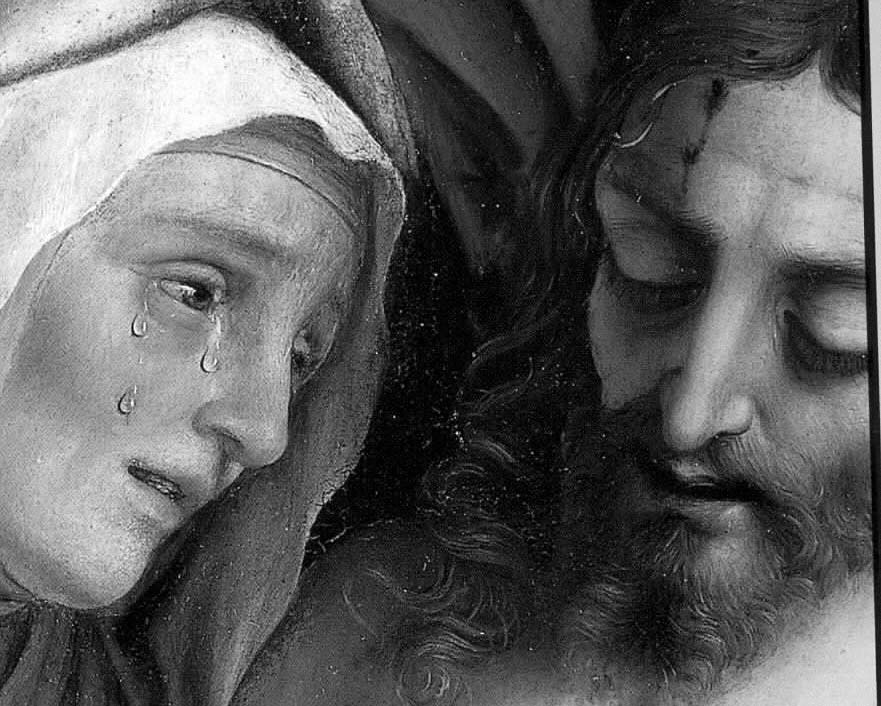 Mary's face with tears near the face of the Crucified Christ.