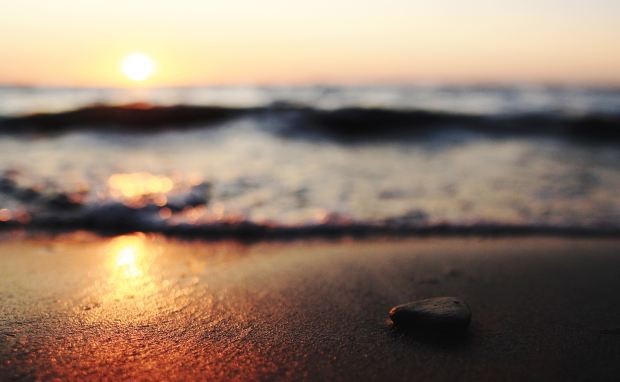 Sunset reflected on the sand of the beach