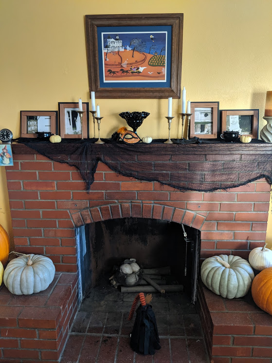 Halloween decor on a brick fireplace