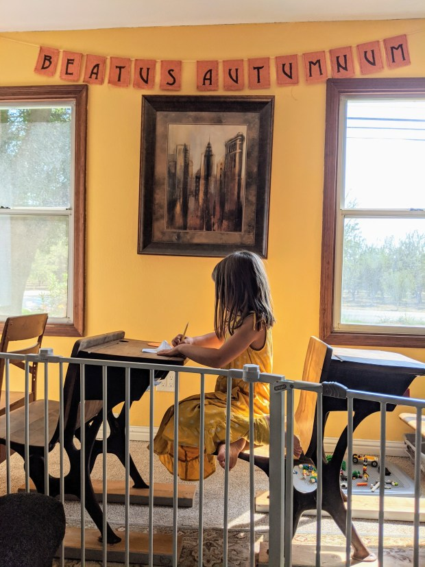 Homeschool room in the living room with fall decor