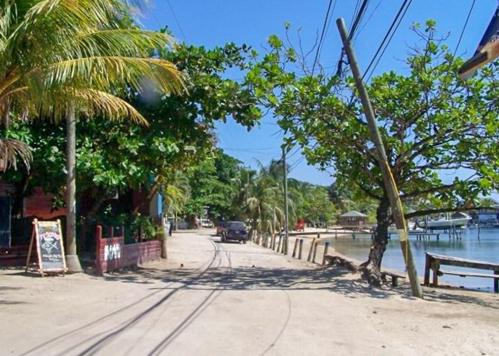 sandy main street in West Bay Roatan, Honduras