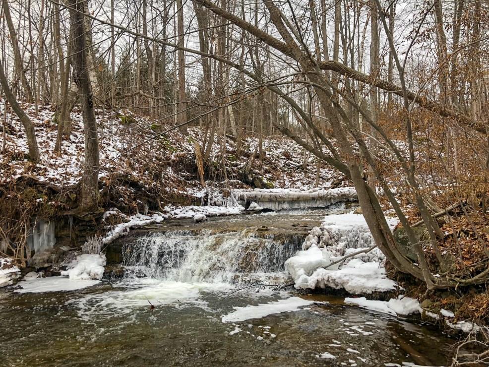 Beautiful Frozen Waterfall on hike in Silvercreek Conservation Area #silvercreekconservationarea #brucetrail #womenwhoexplore #womenwhoexploreontario #discoveron #ontarioforyou #girloutdoor #girlsthatwander #hikingculture #gogalavanting #girlswhohike #explorecanada