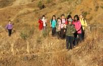 The girls make their way through the hillside paths.
