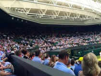 The neatly and smartly dressed men and women of centre court.