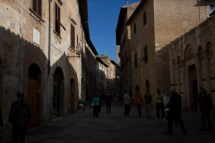 2-stops under exposed. San Gimignano, Italy, tourists, tourist attraction, hill town, Tuscany, Italy