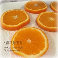 Blot orange slices with kitchen paper before drying in the oven