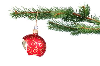 Broken Christmas decoration hanging on a tree