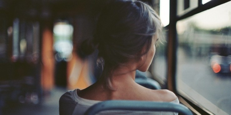 cropped-girl-sitting-on-a-bus-14857.jpg