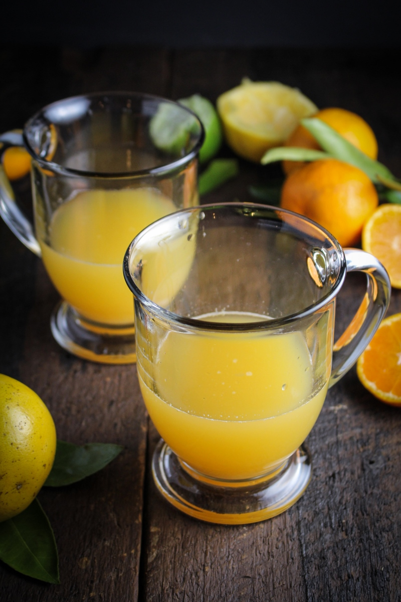 Ecuadorian Canelazo - Cinnamon Syrup, Citrus Juice, and Aguardiente, served warm {Katie at the Kitchen Door}
