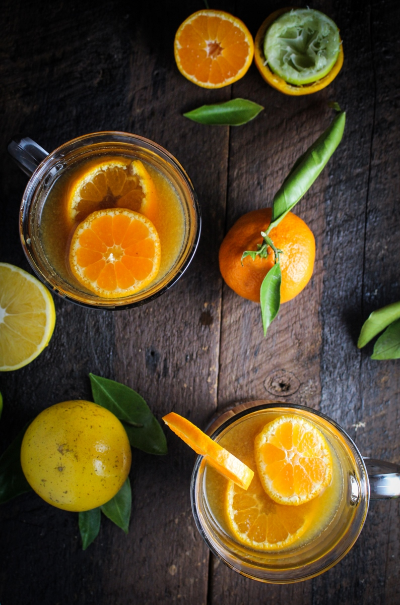 12 Festive Winter Cocktails  - Ecuadorian Canelazo - Cinnamon Syrup, Citrus Juice, and Aguardiente, served warm {Katie at the Kitchen Door}