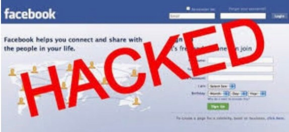 This is a screenshot of the facebook log in page with the word hacked written in red text