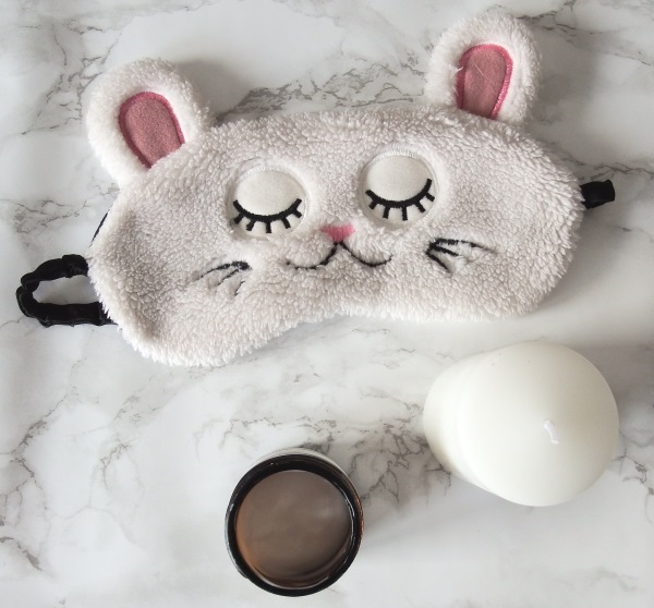 Cat Sleep Mask and Candle to Get The Best Night's Sleep