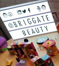 Light box showing the words @briggatebeauty with some of the Christmas 2017 products