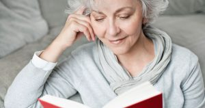 image of woman with gray hair reading
