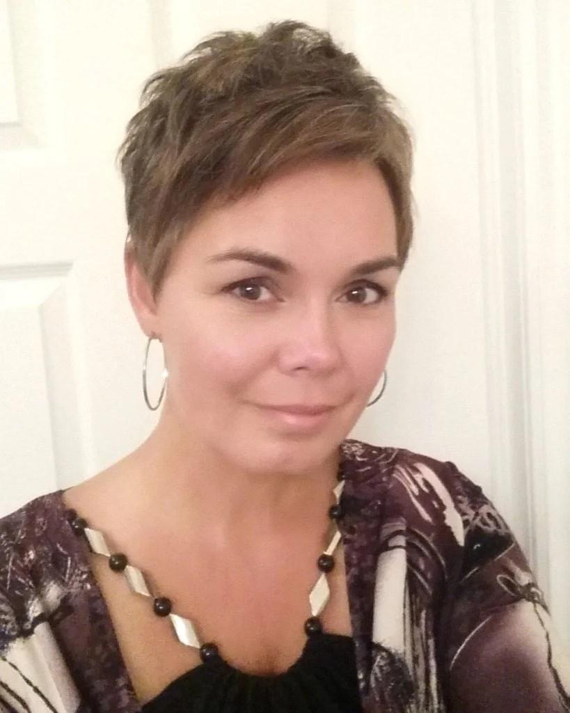 woman graying hair pixie cut
